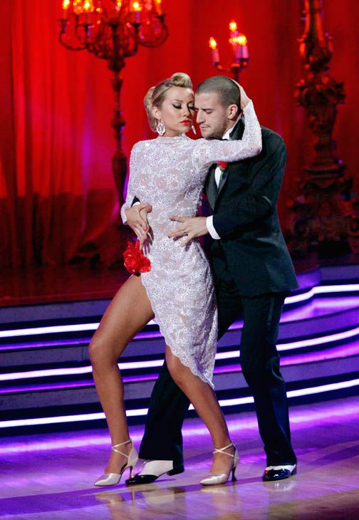 "<div class=""meta ""><span class=""caption-text "">Chelsea Kane and her partner Mark Ballas dance an Argentine Tango, a Rumba and an Instant Cha Cha on week nine of 'Dancing With The Stars.' The judges gave the couple 28 out of 30 for their Argentine Tango and 30 points out of 30 for their Rumba. The couple earned a total of 58 out of 60. They also earned an extra 15 points for winning the Instant Cha Cha round. (Photo/Adam Taylor)</span></div>"