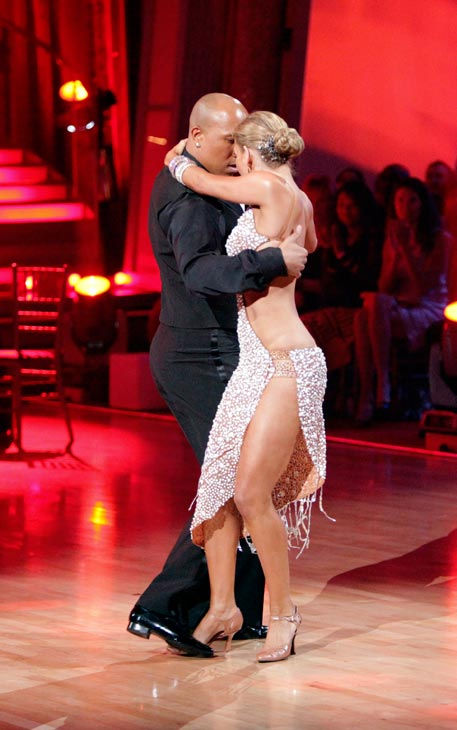 "<div class=""meta image-caption""><div class=""origin-logo origin-image ""><span></span></div><span class=""caption-text"">Hines Ward and his partner Kym Johnson dance a Tango, a Salsa and an Instant Cha Cha on week nine of 'Dancing With The Stars.' The judges gave the couple 30 out of 30 for their Argentine Tango and 30 points out of 30 for their Salsa. The couple earned a total of 60 out of 60. (ABC Photo/ Adam Taylor)</span></div>"