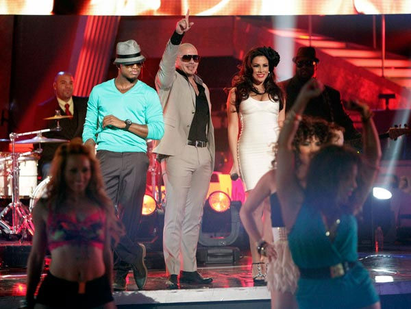 "<div class=""meta ""><span class=""caption-text "">Pitbull also stopped by to perform 'Give Me Everything' with Ne-Yo and Nayer.  (ABC Photo/ Adam Taylor)</span></div>"