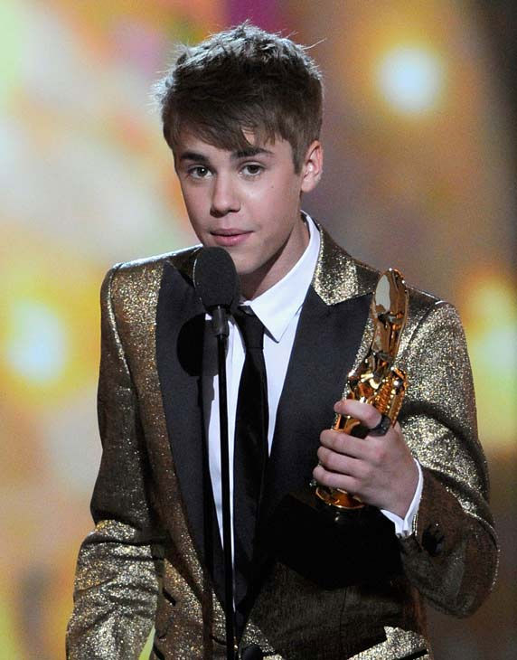 "<div class=""meta image-caption""><div class=""origin-logo origin-image ""><span></span></div><span class=""caption-text"">Justin Bieber wins at the 2011 Billboard Music Awards in Las Vegas on Sunday, May 22, 2011. (ABC Photo/ Ethan Miller)</span></div>"