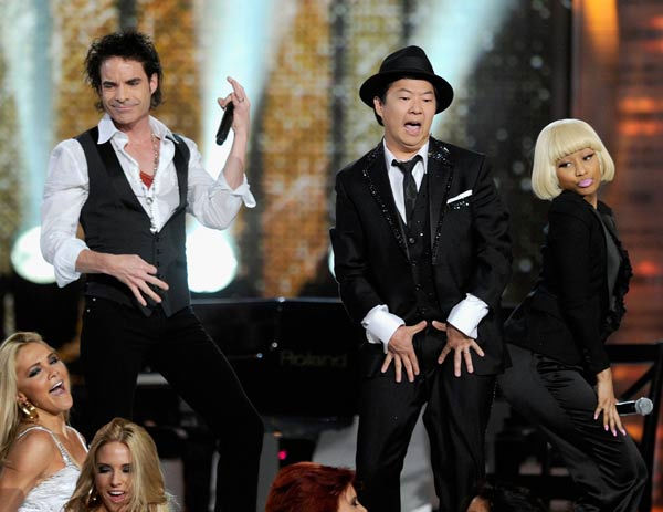 "<div class=""meta image-caption""><div class=""origin-logo origin-image ""><span></span></div><span class=""caption-text"">Comedian and 2011 Billboard Awards host Ken Jeong performs with Nicki Minaj and Train frontman Pat Monahan in Las Vegas on Sunday, May 22, 2011. (ABC Photo/ Ethan Miller)</span></div>"