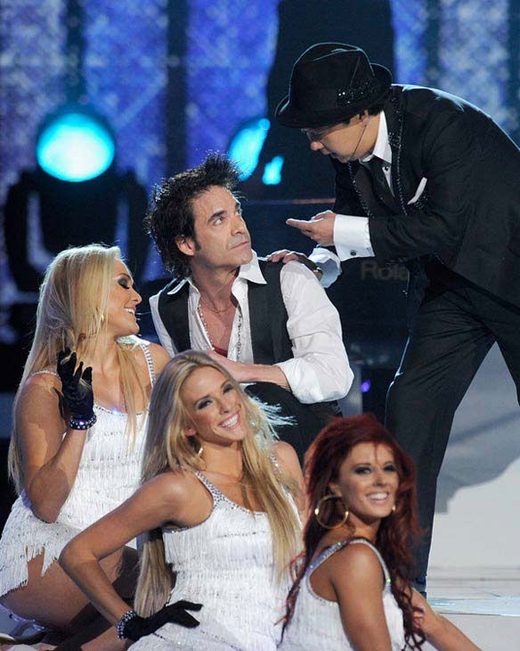 Comedian and 2011 Billboard Awards host Ken Jeong performs with Nicki Minaj and Train frontman Pat Monahan in Las Vegas on Sunday, May 22, 2011.