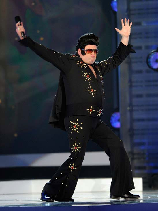 "<div class=""meta ""><span class=""caption-text "">'Modern Family' star Eric Stonestreet dons a black Elvis costume with Billboard Awards host Ken Jeong in White at the 2011 Billboard Music Awards in Las Vegas on Sunday, May 22, 2011. (ABC Photo/ Ethan Miller)</span></div>"