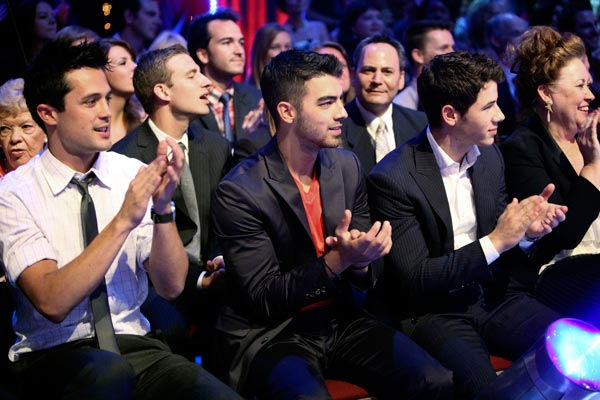 "<div class=""meta ""><span class=""caption-text "">Joe and Nick Jonas appear on 'Dancing With The Stars' on May 23, 2011. (ABC Photo/ Adam Taylor)</span></div>"