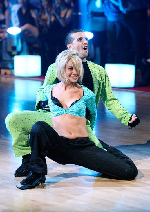 Chelsea Kane and her partner Mark Ballas dance a...