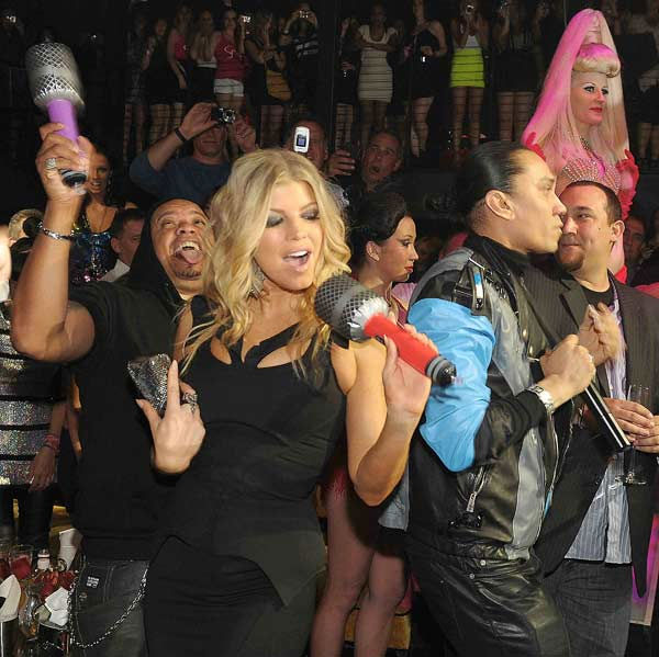 "<div class=""meta ""><span class=""caption-text "">Fergie and Taboo of The Black Eyed Peas perform at Haze Nightclub on May 20, 2011 in Las Vegas. (Denise Truscello/Wireimage)</span></div>"