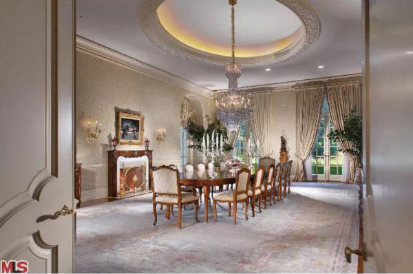 "<div class=""meta ""><span class=""caption-text "">The dining room of Aaron Spelling's 57,000-square foot Los Angeles home, which had a $150 million asking price and is in contract to be sold to 22-year-old heiress Petra Ecclestone, daughter of billionaire Formula One racing boss Bernard Ecclestone. (Photo/Realtor.com)</span></div>"