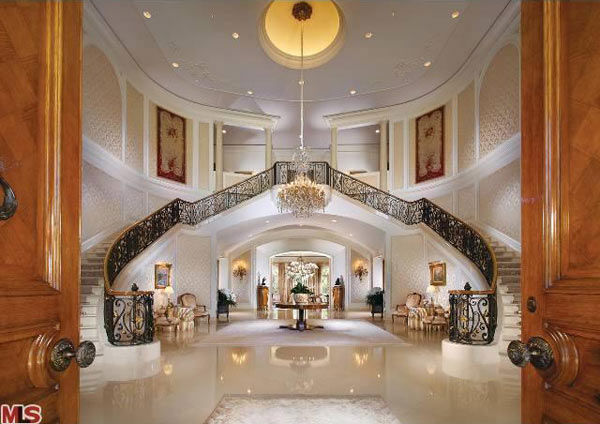 "<div class=""meta ""><span class=""caption-text "">The entry way to Aaron Spelling's 57,000-square foot Los Angeles home, which had a $150 million asking price and is in contract to be sold to 22-year-old heiress Petra Ecclestone, daughter of billionaire Formula One racing boss Bernard Ecclestone. (Photo/Realtor.com)</span></div>"