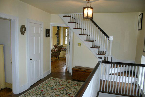 The stairway in the five-bedroom home featured...