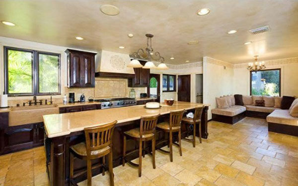 The kitchen at Katy Perry and Russell Brand&#39;s Hollywood Hills home. The seven-bedroom, nine bathroom house is 8,835 square feet and was purchased by the couple for &#36;6.5 million. <span class=meta>(Photo&#47;Realtor.com)</span>