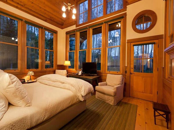 A guest bedroom in Jerry Seinfeld's mansion in Telluride, Colorado which has 11 bedrooms, 11 bathrooms, mountain views and a creek and is on the market for $18 million.