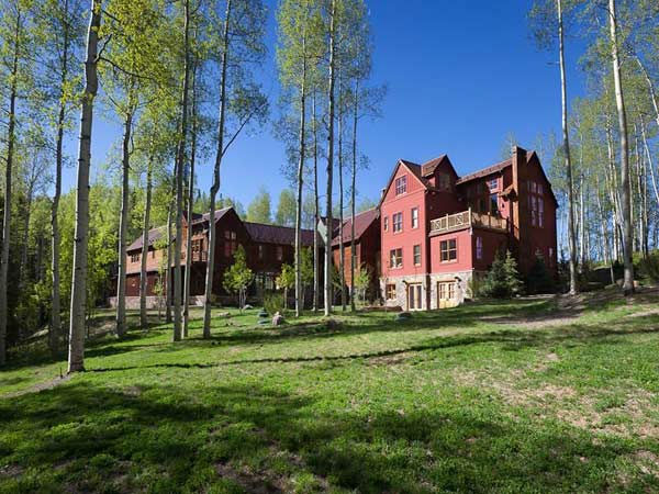 An outside view of Jerry Seinfeld's mansion in Telluride, Colorado which has 11 bedrooms, 11 bathrooms, mountain views and a creek and is on the market for $18 million.
