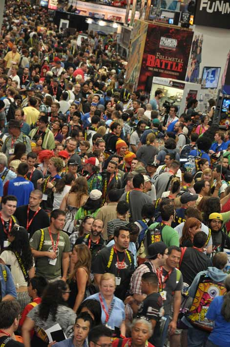 Fans flood into the convention floor for a  sneak peak of this year's Comic-Con in San Diego on Wednesday, July 20, 2011.