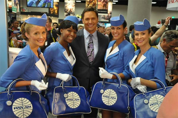On The Red Carpet host Chris Balish poses with Pan Am Girls at Comic-Con in San Diego on Wednesday, July 20, 2011. <span class=meta>(OTRC Photo)</span>