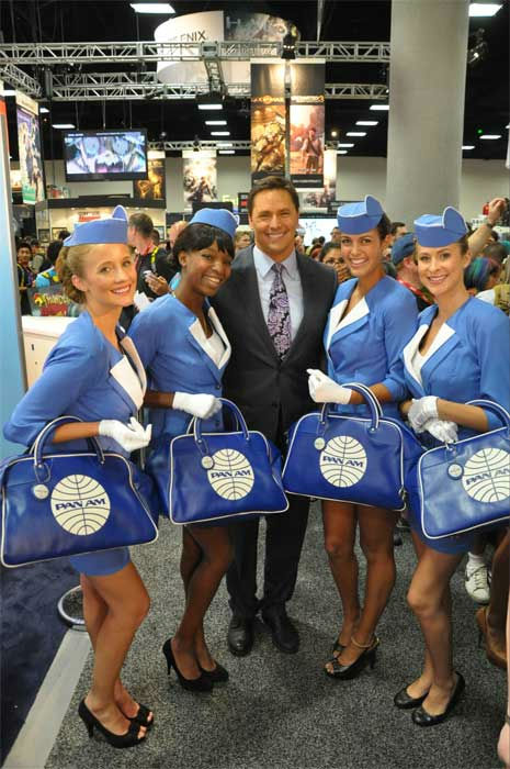 "<div class=""meta image-caption""><div class=""origin-logo origin-image ""><span></span></div><span class=""caption-text"">On The Red Carpet host Chris Balish poses with Pan Am Girls at Comic-Con in San Diego on Wednesday, July 20, 2011. (OTRC Photo)</span></div>"