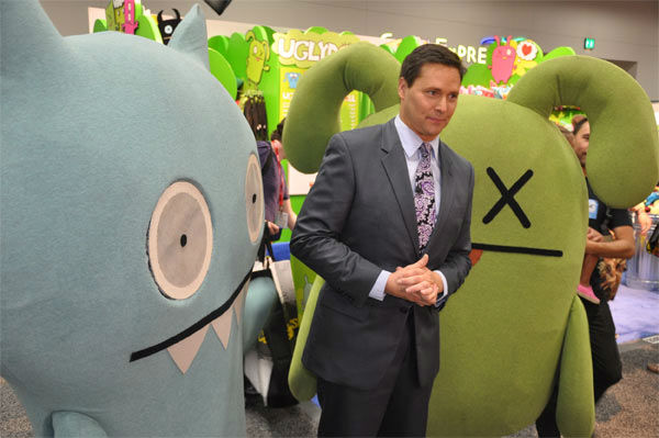 On The Red Carpet host Chris Balish poses with people dressed in Uglydoll costumes at Comic-Con in San Diego on Wednesday, July 20, 2011. <span class=meta>(OTRC Photo)</span>
