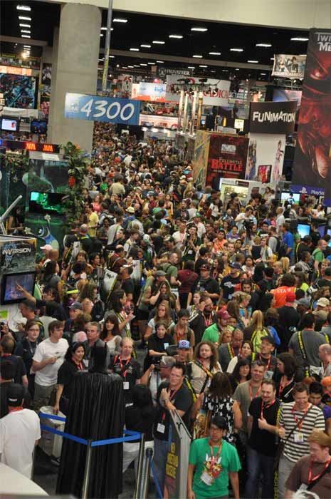 "<div class=""meta ""><span class=""caption-text "">Fans flood into the convention floor for a sneak peak of this year's Comic-Con in San Diego on Wednesday, July 20, 2011. (OTRC Photo)</span></div>"