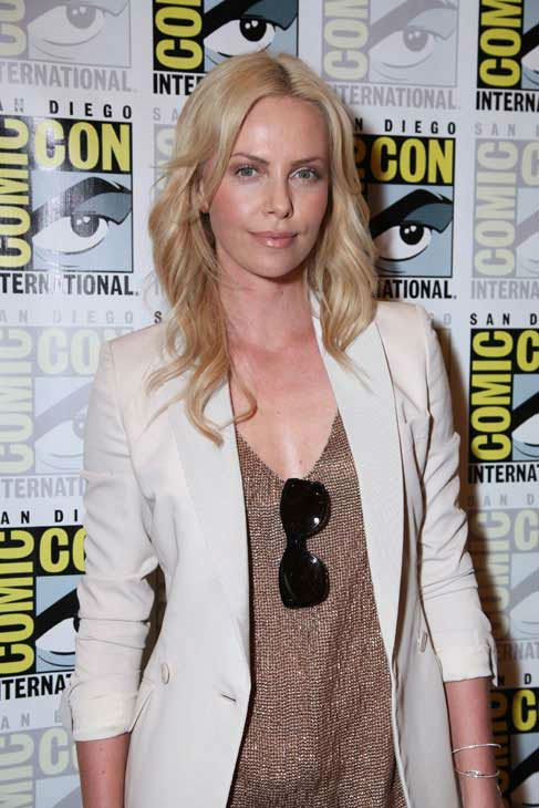 "<div class=""meta ""><span class=""caption-text "">Charlize Theron poses for photographs prior to the 'Prometheus' press conference at Comic Con in San Diego, CA on Thursday July 21, 2011. (Alex J. Berliner/ABImages)</span></div>"