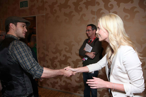 Justin Timberlake shakes hands with Charlize Theron between press conferences at Comic Con in San Diego, CA on Thursday July 21, 2011. <span class=meta>(Alex J. Berliner&#47;ABImages)</span>