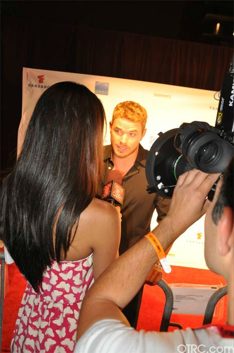 "<div class=""meta image-caption""><div class=""origin-logo origin-image ""><span></span></div><span class=""caption-text"">On The Red Carpet co-host Rachel Smith interviews Kellan Lutz from 'The Twilight Saga' at the Summit Comic-Con party sponsored by Butterfinger at the Hard Rock Hotel in San Diego on Thursday, July 21, 2011. (OTRC Photo)</span></div>"