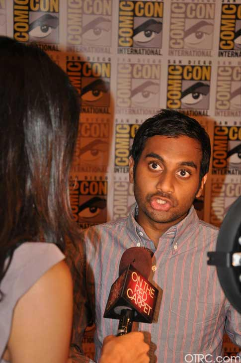 "<div class=""meta image-caption""><div class=""origin-logo origin-image ""><span></span></div><span class=""caption-text"">Aziz Ansari from the '30 Minutes or Less' panel appears in a photo at Comic-Con in San Diego on Friday, July 22, 2011.The film is scheduled to be released on August 12, 2011. (OTRC Photo)</span></div>"