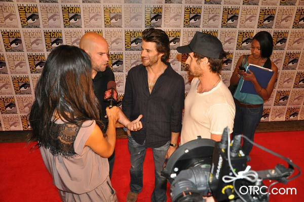"<div class=""meta ""><span class=""caption-text "">'Ghost Rider: Spirit of Vengeance' directors Mark Neveldine and Brian Taylor and actor Johnny Whitworth, who plays human-turned-demon Blackout talk to OnTheRedCarpet.com co-host Rachel Smith at San Diego Comic-Con on Friday, July 22, 2011. Columbia Pictures has set February 17, 2012 as the U.S. release date for the action fantasy movie.  (OTRC)</span></div>"
