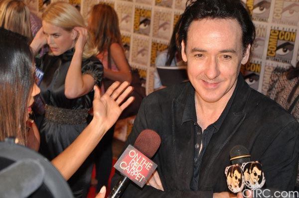 "<div class=""meta image-caption""><div class=""origin-logo origin-image ""><span></span></div><span class=""caption-text"">John Cusack from 'The Raven' panel appears in a photo at Comic-Con in San Diego on Friday, July 22, 2011.The film is scheduled to be released on March 9, 2012. (OTRC Photo)</span></div>"