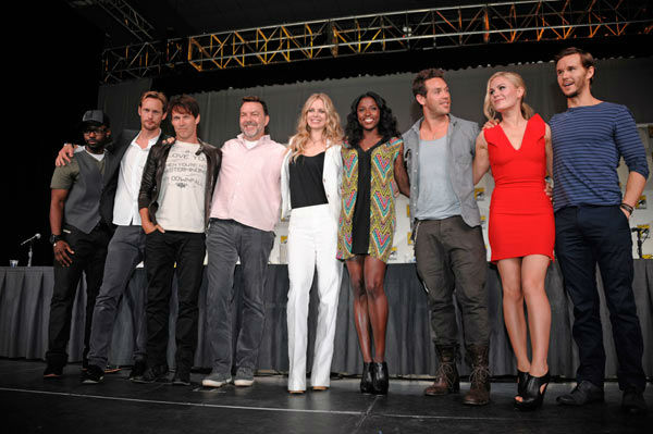 "<div class=""meta image-caption""><div class=""origin-logo origin-image ""><span></span></div><span class=""caption-text"">The cast of  television show ""True Blood"" poses on stage after a panel at the Comic-Con International 2011 convention held in San Diego Friday, July 22, 2011. The annual comic book and popular arts convention attracts over 100,000 people and runs through Sunday July 24. (AP Photo/ DENIS POROY)</span></div>"