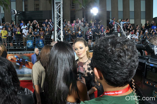 "<div class=""meta ""><span class=""caption-text "">'Cowboys & Aliens' actress Olivia Wilde talks to OnTheRedCarpet.com co-host Rachel Smith at the film's premiere at San Diego Comic-Con on Saturday, July 23, 2011. (OTRC Photo)</span></div>"