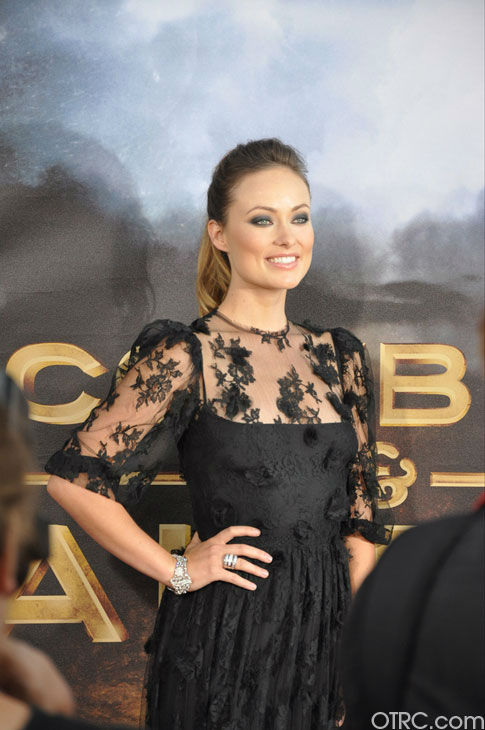 "<div class=""meta image-caption""><div class=""origin-logo origin-image ""><span></span></div><span class=""caption-text"">'Cowboys & Aliens' actress Olivia Wilde appears at the film's premiere at San Diego Comic-Con on Saturday, July 23, 2011. (OTRC Photo)</span></div>"