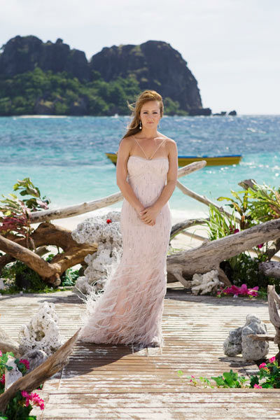 Ashley Hebert appears in a scene from &#39;The Bachelorette&#39; season 7 finale, which aired on Monday, August 1 on ABC. In the episode, she had to choose between the final two bachelors, J.P. and Ben F.  Hebert is wearing a hand-stitched crystal and ostrich feather gown designed by Randi Rahm, which reportedly cost &#36;16,790. <span class=meta>(ABC Photo&#47; Matt Klitscher)</span>