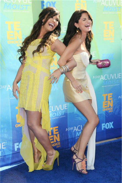 Demi Lovato and Selena Gomez walk the blue carpet at the 2011 Teen Choice Awards at the Gibson Amphitheatre in Universal City, California on Aug. 7, 2011. <span class=meta>(Kyle Rover &#47; Startraksphoto.com)</span>