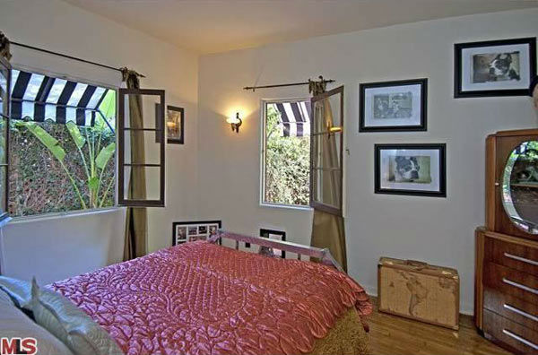 The guest room in Rose McGowan&#39;s former home, located in the Loz Feliz neighborhood of Los Angeles, which was built in 1928 and has 4 bedrooms and 3 bathrooms. The Spanish-style home was sold for &#36;1.7 million in May 2011. <span class=meta>(MLS &#47; Realtor.com)</span>