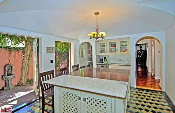 The kitchen island in Rose McGowan&#39;s former home, located in the Loz Feliz neighborhood of Los Angeles, which was built in 1928 and has 4 bedrooms and 3 bathrooms. The Spanish-style home was sold for &#36;1.7 million in May 2011. <span class=meta>(MLS &#47; Realtor.com)</span>