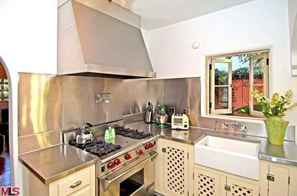The kitchen in Rose McGowan's former home, located in the Loz Feliz neighborhood of Los Angeles, which was built in 1928 and has 4 bedrooms and 3 bathrooms. The Spanish-style home was sold for $1.7 million in May 2011.