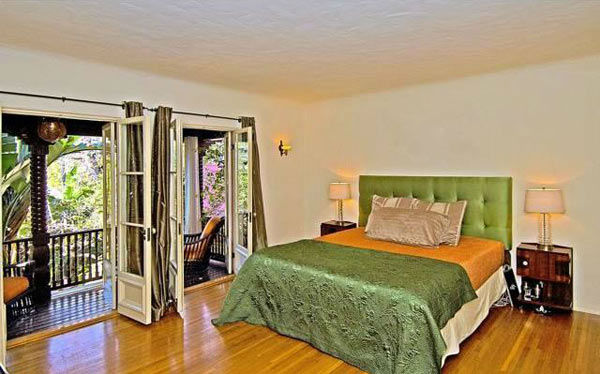 The master bedroom in Rose McGowan&#39;s former home, located in the Loz Feliz neighborhood of Los Angeles, which was built in 1928 and has 4 bedrooms and 3 bathrooms. The Spanish-style home was sold for &#36;1.7 million in May 2011. <span class=meta>(MLS &#47; Realtor.com)</span>