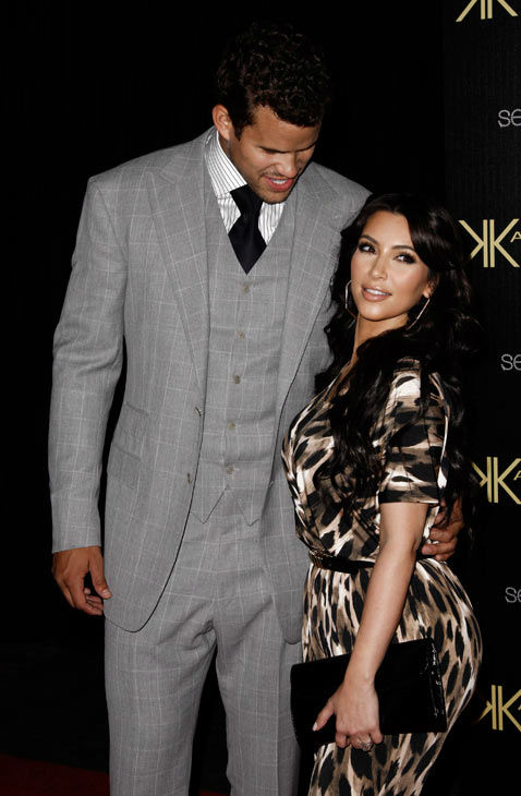 Kim Kardashian, right, and her fiance, NBA basketball pla