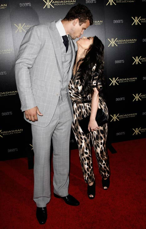 Kim Kardashian, right, and her fiance, NBA basketball player