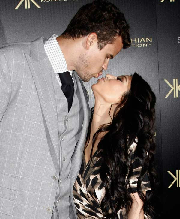 Kim Kardashian, right, and her fiance, NBA...