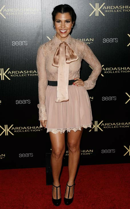"<div class=""meta ""><span class=""caption-text "">Kourtney Kardashian arrives at the Kardashian Kollection launch party in Los Angeles, Wednesday, Aug. 17, 2011. The Kardashian Kollection designed by the Kardashian sisters is available at Sears.  (AP Photo/ Matt Sayles)</span></div>"