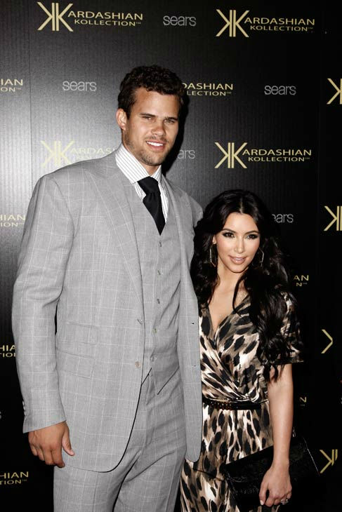 Kim Kardashian, right, and her fiance, NBA basketball player Kris Humphries, arrive at the Kardashian Kollection launch party in Los Angeles, Wednesday, Aug. 17, 2011. The Kardashian Kollection designed by the Kardashian sisters is available at Sears.  <span class=meta>(AP Photo&#47; Matt Sayles)</span>
