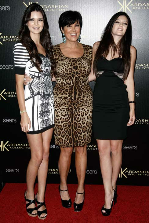 "<div class=""meta ""><span class=""caption-text "">Kris Jenner, center, Kylie Jenner, right, and Kendall Jenner arrive at the Kardashian Kollection launch party in Los Angeles, Wednesday, Aug. 17, 2011. The Kardashian Kollection designed by the Kardashian sisters is available at Sears.  (AP Photo/ Matt Sayles)</span></div>"