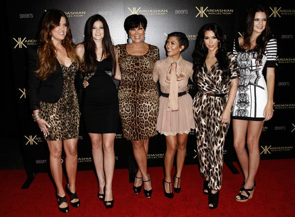 From left, Khloe Kardashian, Kylie Jenner, Kris Jenner, Kourtney Kardashian, Kim Kardashian, and Kendall Jenner pose together at the Kardashian Kollection launch party in Los Angeles, Wednesday, Aug. 17, 2011. The Kardashian Kollection designed by the Kardashian sisters is available at Sears. <span class=meta>(AP Photo&#47; Matt Sayles)</span>