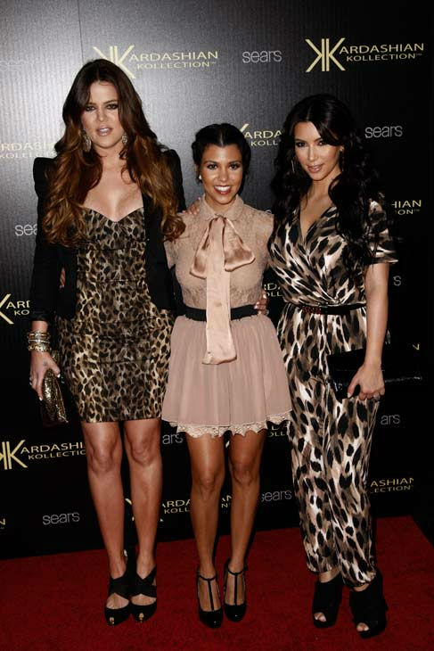 "<div class=""meta ""><span class=""caption-text "">Khloe Kardashian, Kourtney Kardashian and Kim Kardashian arrive at the Kardashian Kollection launch party in Los Angeles, Wednesday, Aug. 17, 2011. The Kardashian Kollection designed by the Kardashian sisters is available at Sears. (AP Photo/ Matt Sayles)</span></div>"