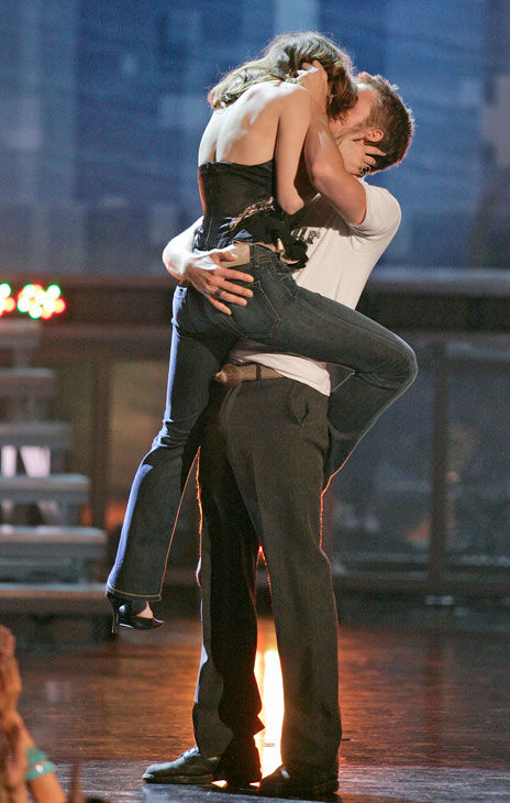 Rachel McAdams and Ryan Gosling kiss on stage as they accept the award for best kiss for their work in 'The Notebook,' during the MTV Movie Awards on Saturday, June 4, 2005, in Los Angeles.