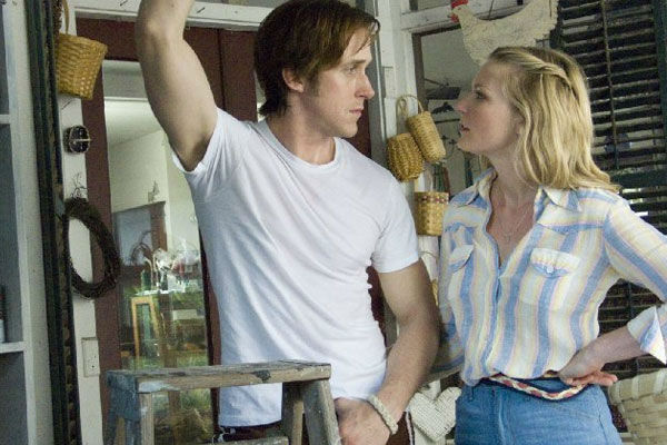 Kirsten Dunst and Ryan Gosling appear in a scene...