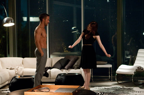 Ryan Gosling and Emma Stone appear in a scene...