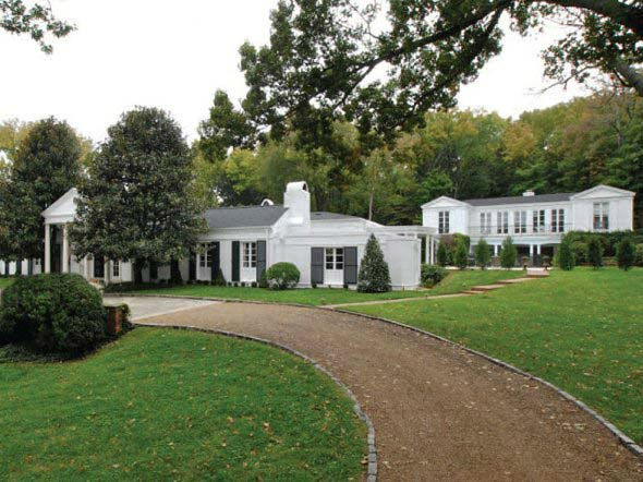 The driveway to Taylor Swift's four-bedroom,...