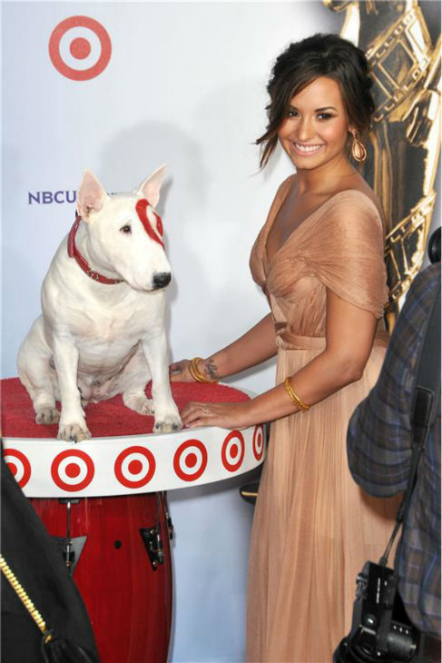 Demi Lovato poses with Bullseye the Target dog at the 2011 National Council of La Raza &#40;NCLR&#41; American Latino Media Arts Awards &#40;ALMAs&#41; in Santa Monica, California on Sept. 10, 2011. <span class=meta>(Tony DiMaio &#47; startraksphoto.com)</span>