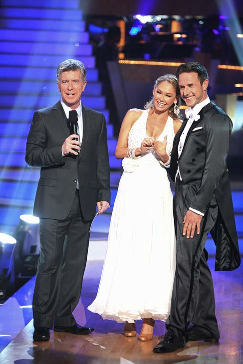 Actor David Arquette and his partner Kym Johnson talk with 'Dancing With The Stars' co-host Tom Bergeron after being safe from elimination on 'Dancing With The Stars: The Res